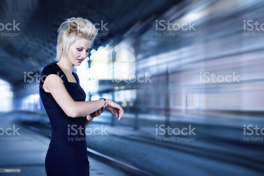 woman looking at watch royalty-free stock photo