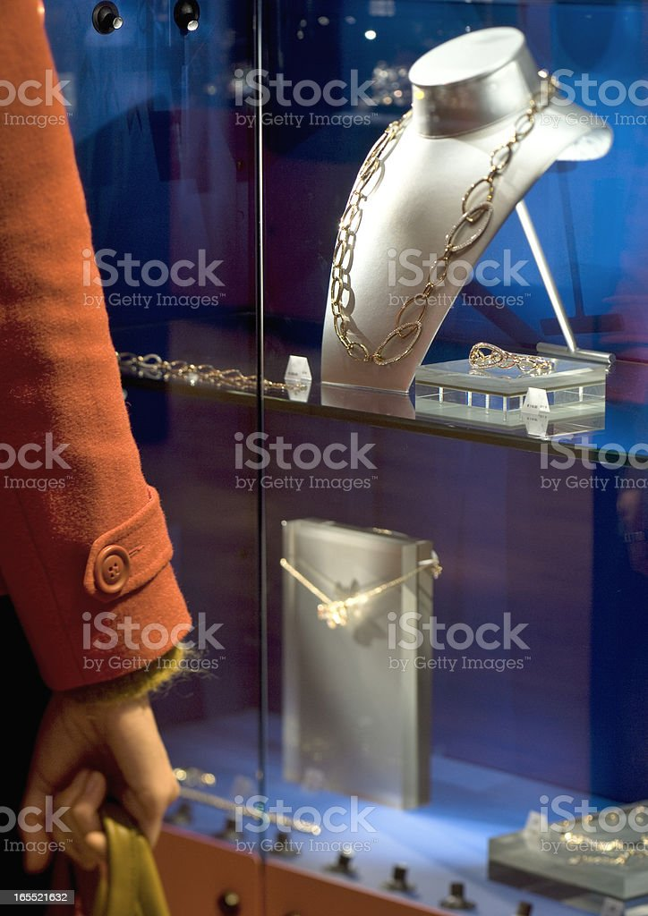 woman looking at window display of jewelry store royalty-free stock photo
