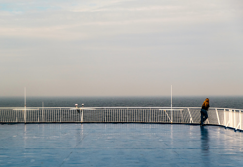 Woman looking away on ferry deck