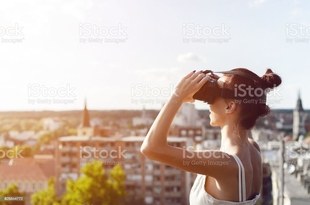 woman looking big city with virtual reality headset stock photo
