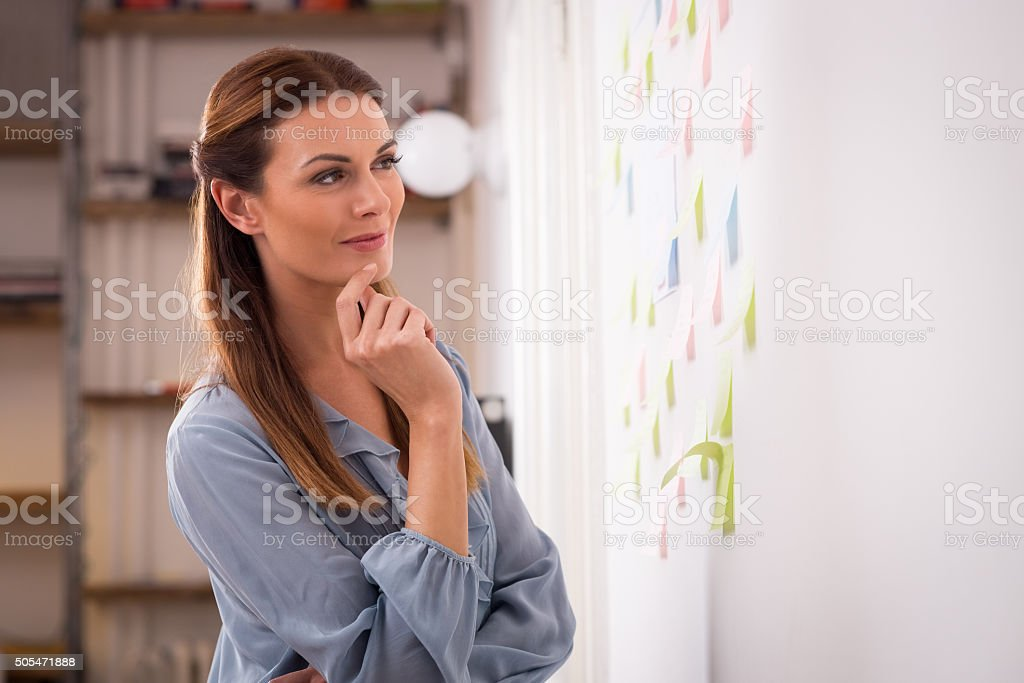 Woman looking business plan stock photo