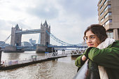 ReWoman looking busy and energetic cityscape of London, England