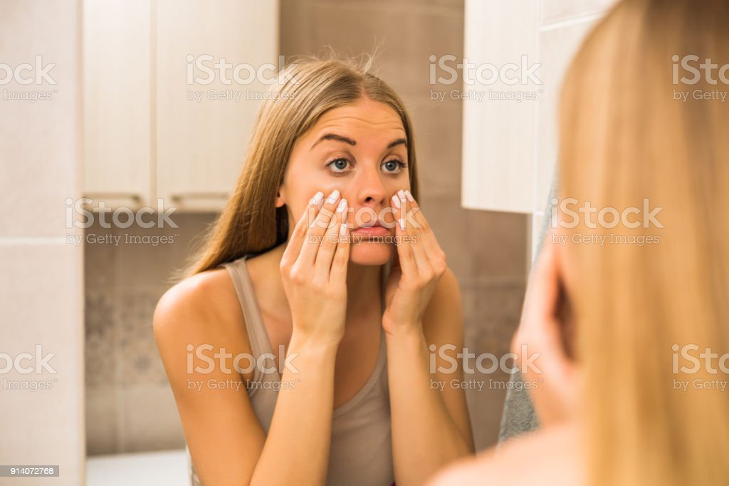 Woman looking eye bags - Royalty-free Adult Stock Photo
