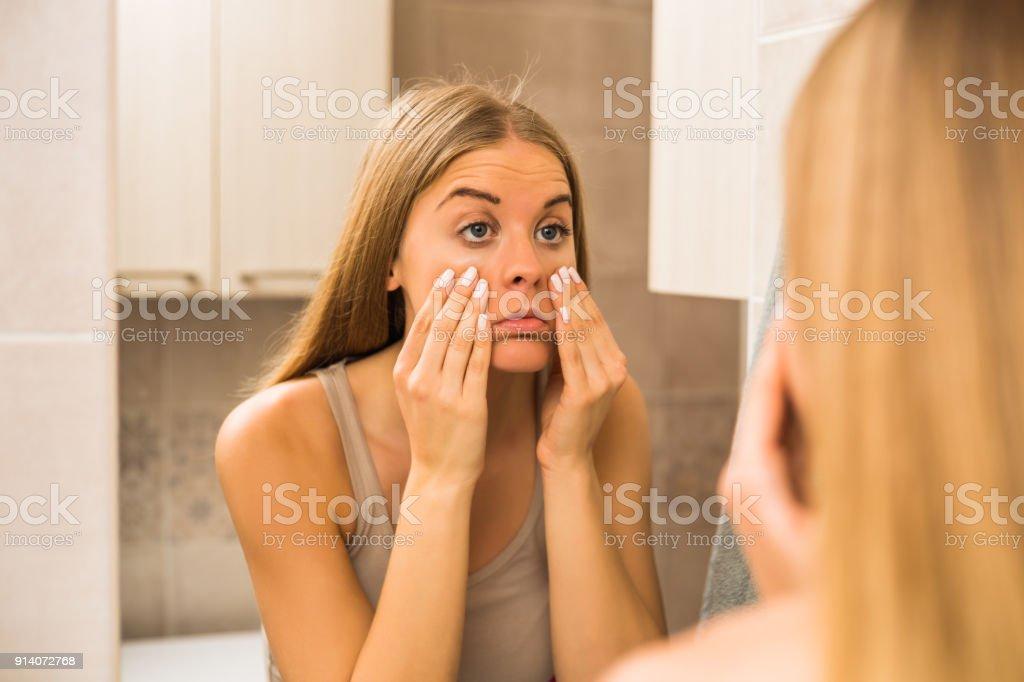 Woman looking eye bags stock photo
