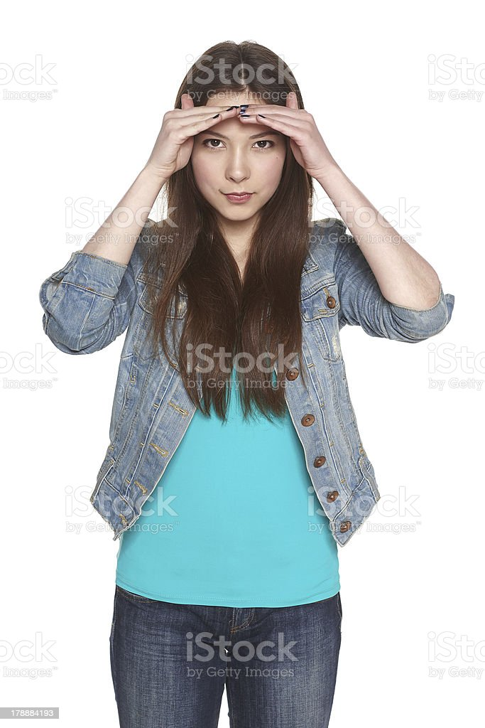 Woman looking forward with her palm on the forehead stock photo