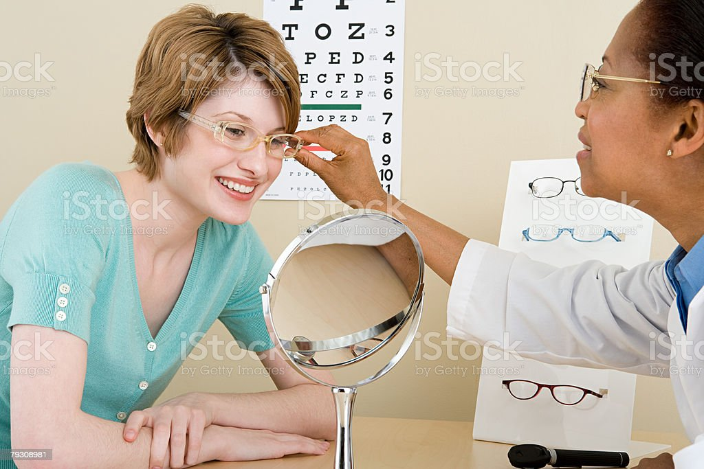 A woman looking in mirror royalty-free stock photo