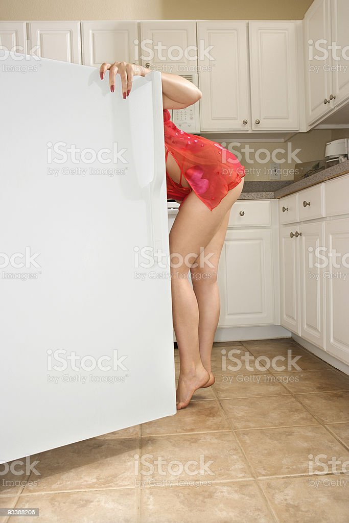 Woman looking in refrigerator. royalty-free stock photo