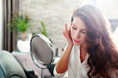 istock woman looking in the mirror 540577468