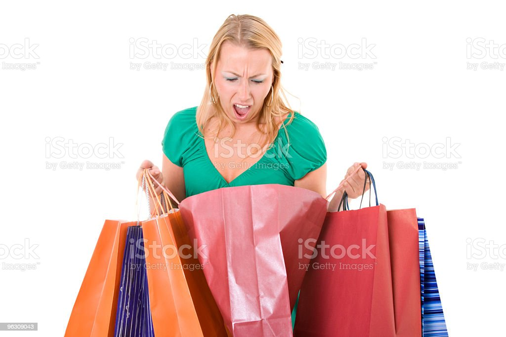 Woman looking inside a shopping bag royalty-free stock photo