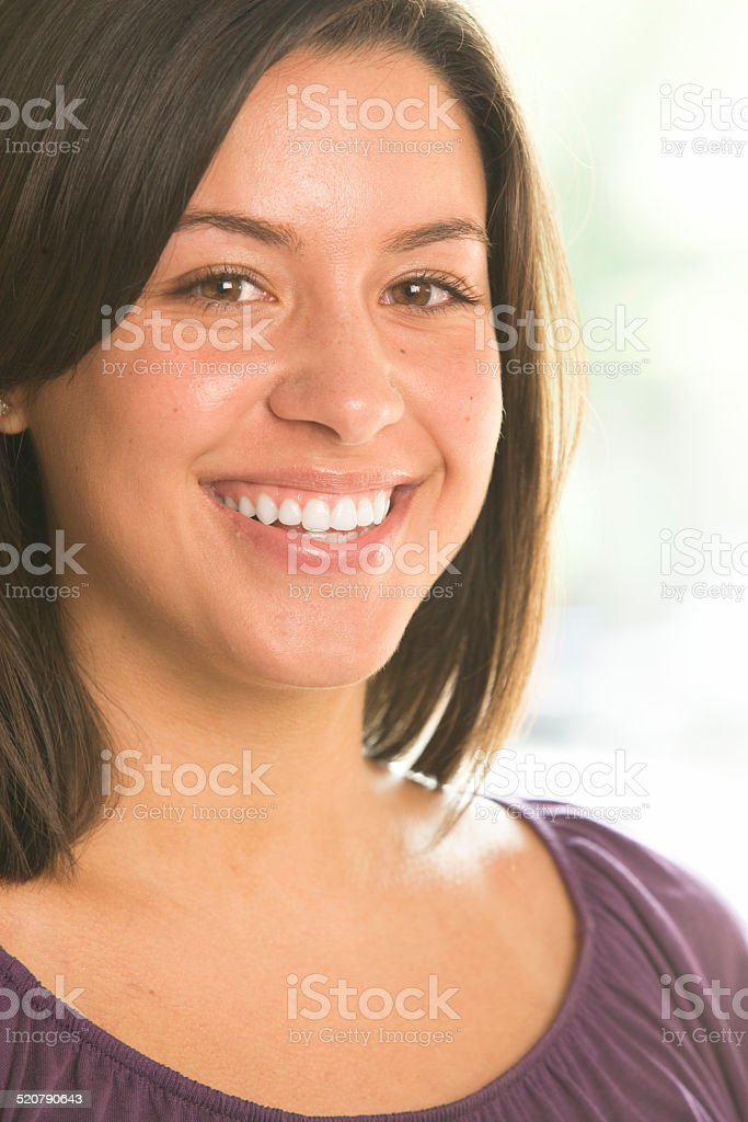 Woman Looking into Camera and Smiling stock photo