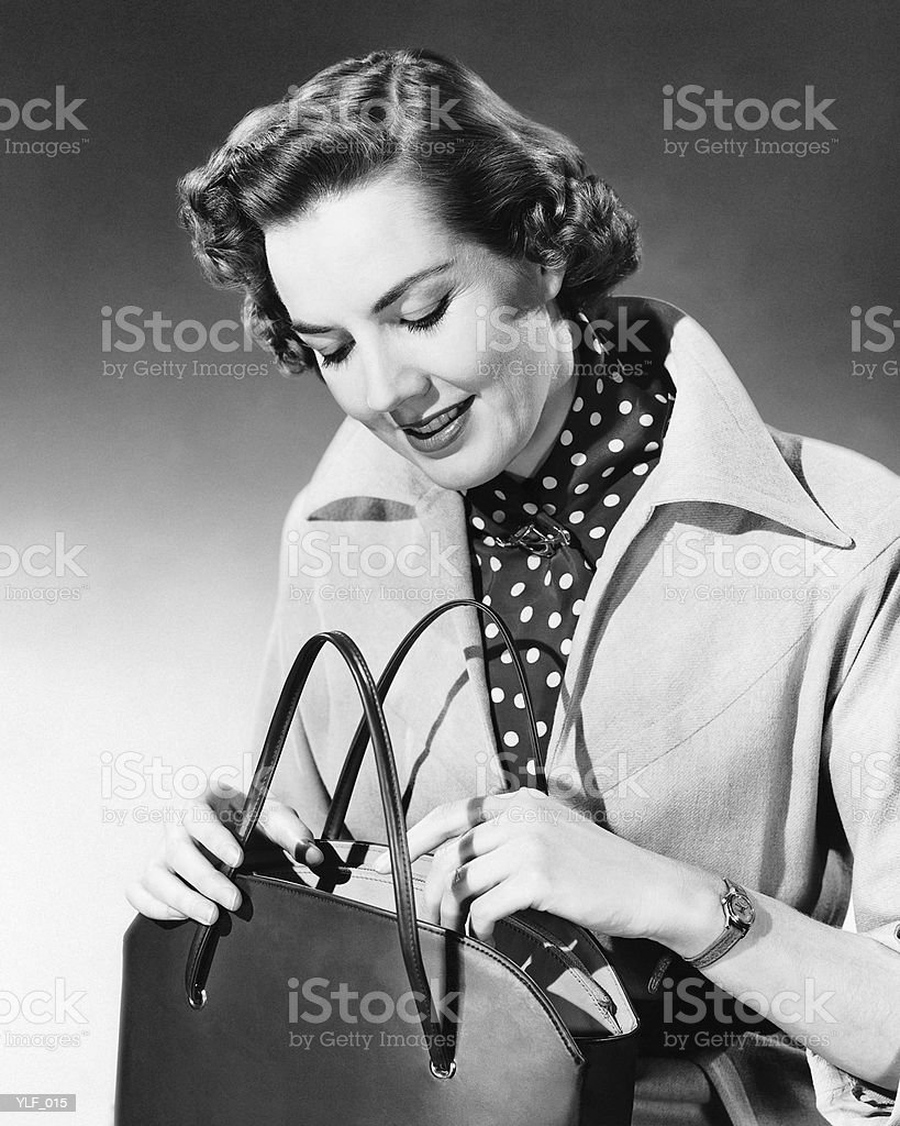 Woman looking into purse royalty-free stock photo