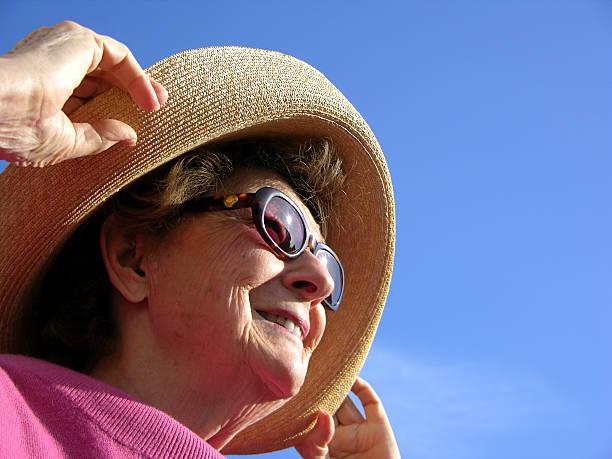 Woman looking into sun stock photo