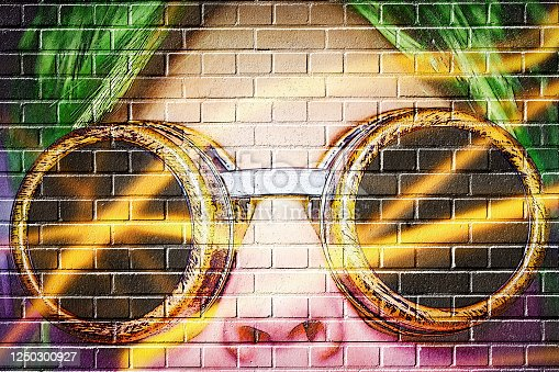 womans face on a brick wall - the graffitilook is not a real graffiti it is a manipulated photopraphy