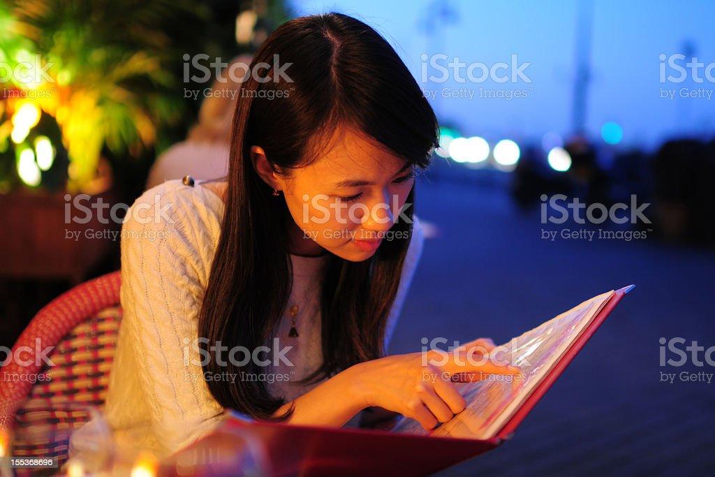 Woman Looking Menu At Restaurant stock photo