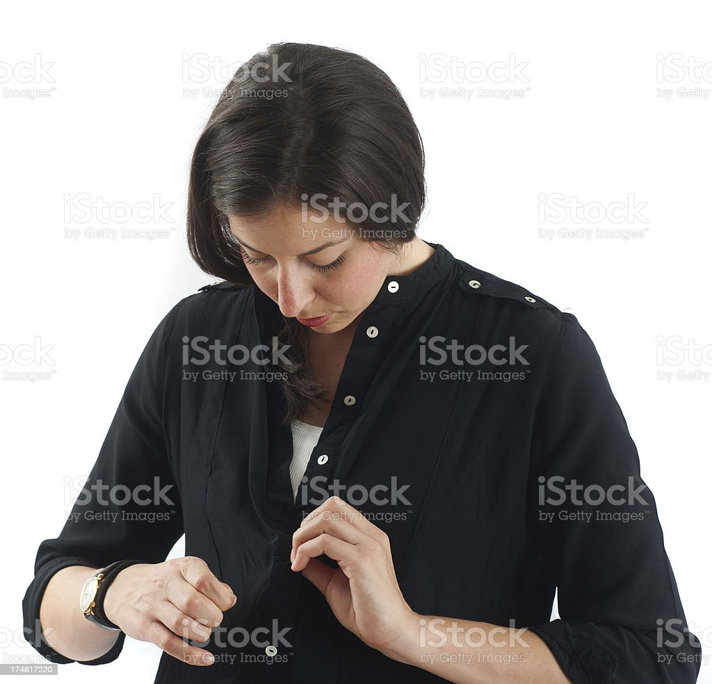 woman looking on spot at black jacket stock photo
