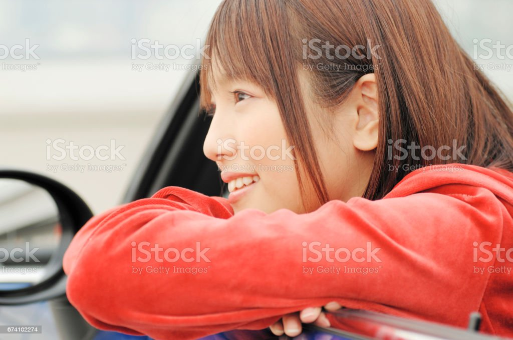 Woman looking out from a convertible car royalty-free stock photo
