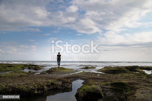 istock Woman Looking Out to Sea 896369048