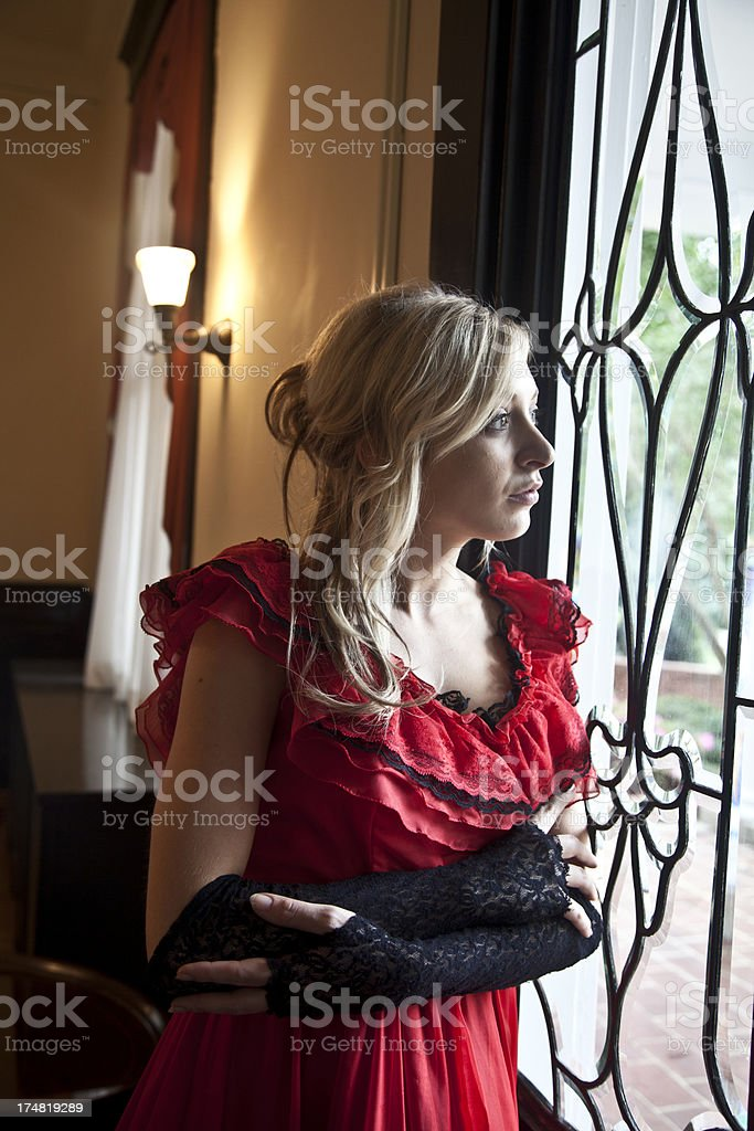 Woman Looking out Window stock photo