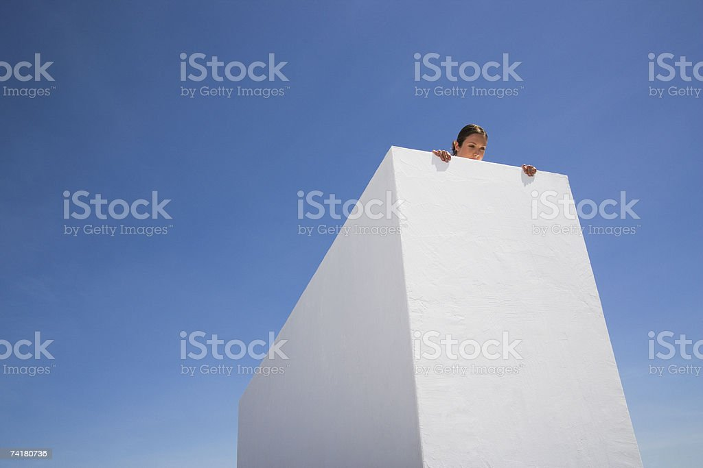 Woman looking over edge of roof royalty-free stock photo