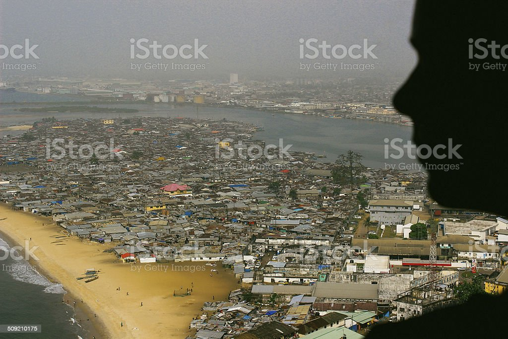 Woman looking over Monrovia, Liberia stock photo