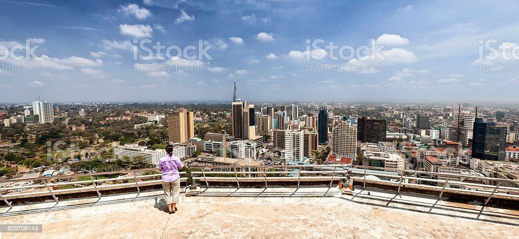 woman looking over Nairobi stock photo