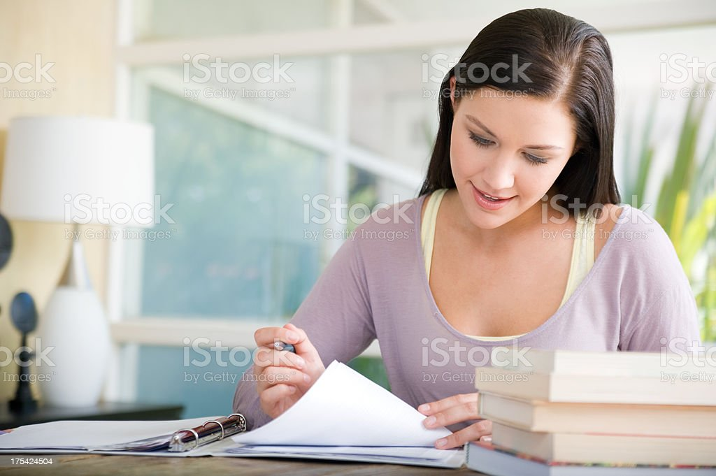 Woman looking over papers stock photo