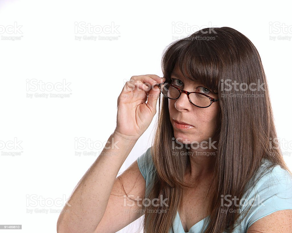 Woman looking over the top of her glasses stock photo