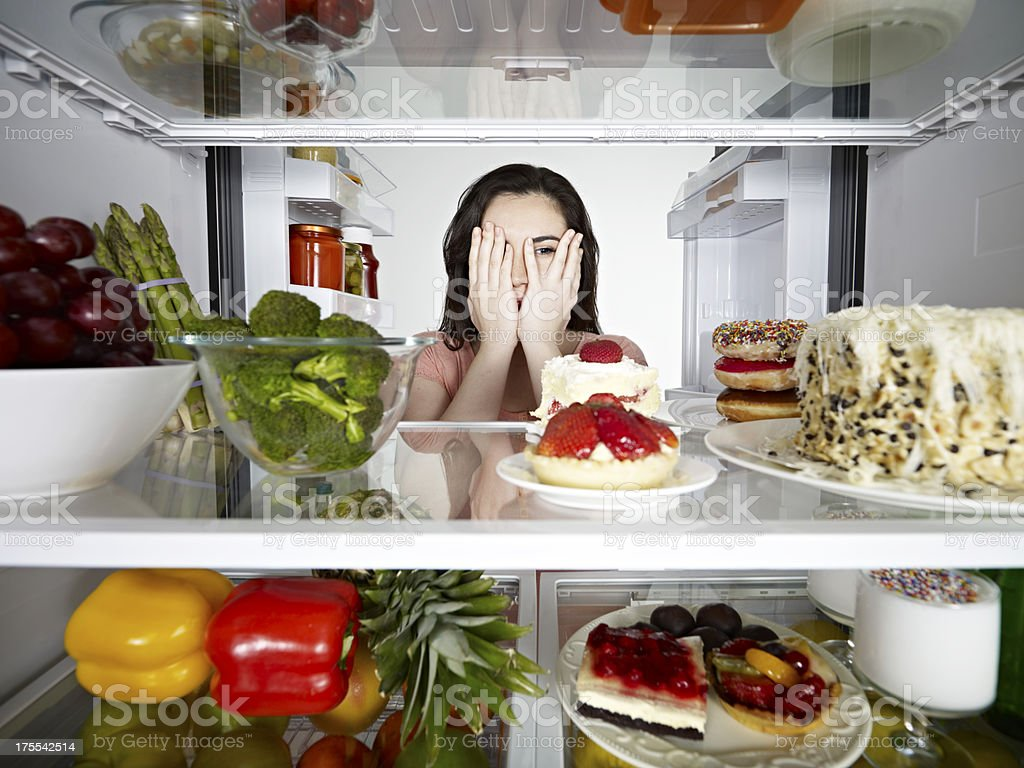Woman Looking secretly to a Cake stock photo