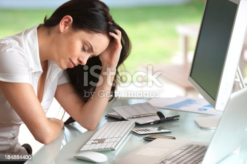 Woman Looking Stressed At Her Desk Stock Photo & More Pictures of Adult