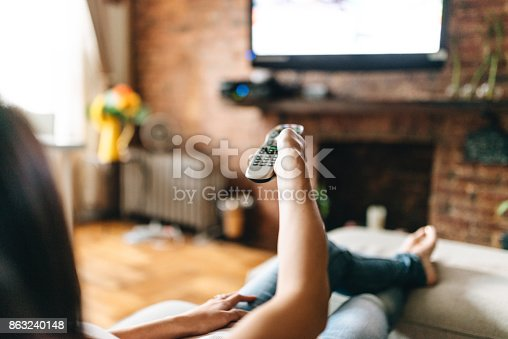woman looking the tv at home
