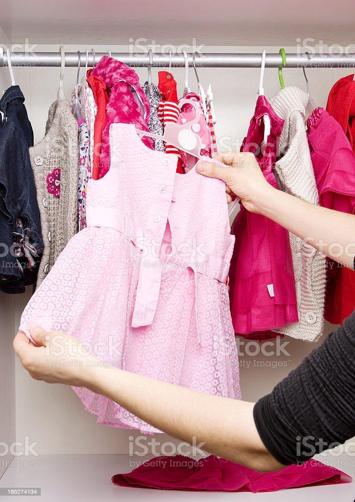 Woman looking through a closet royalty-free stock photo