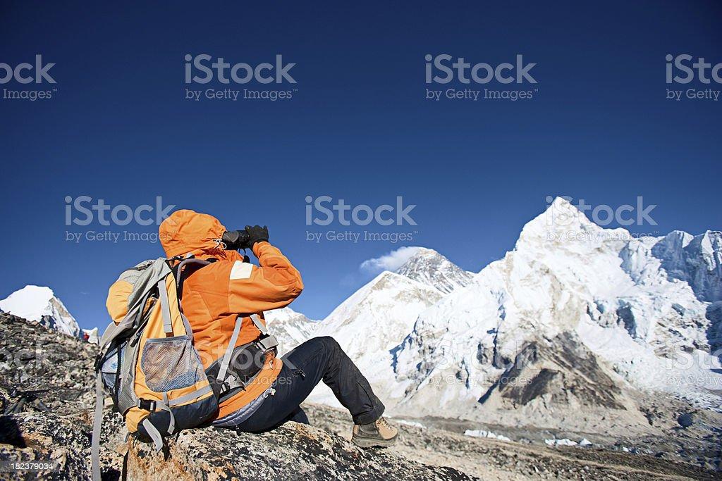 Woman looking through binoculars at Mount Everest royalty-free stock photo