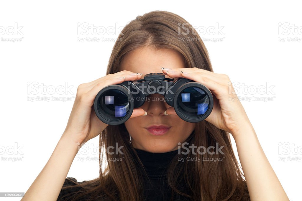 Woman looking through binoculars royalty-free stock photo