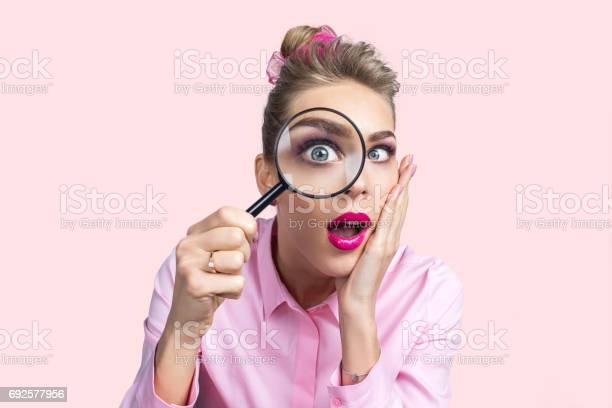 Woman looking through magnifying glass picture id692577956?b=1&k=6&m=692577956&s=612x612&h=yarcslrokws tuzqbdlqeszmrzhwjrjmswrdwrtbbrm=