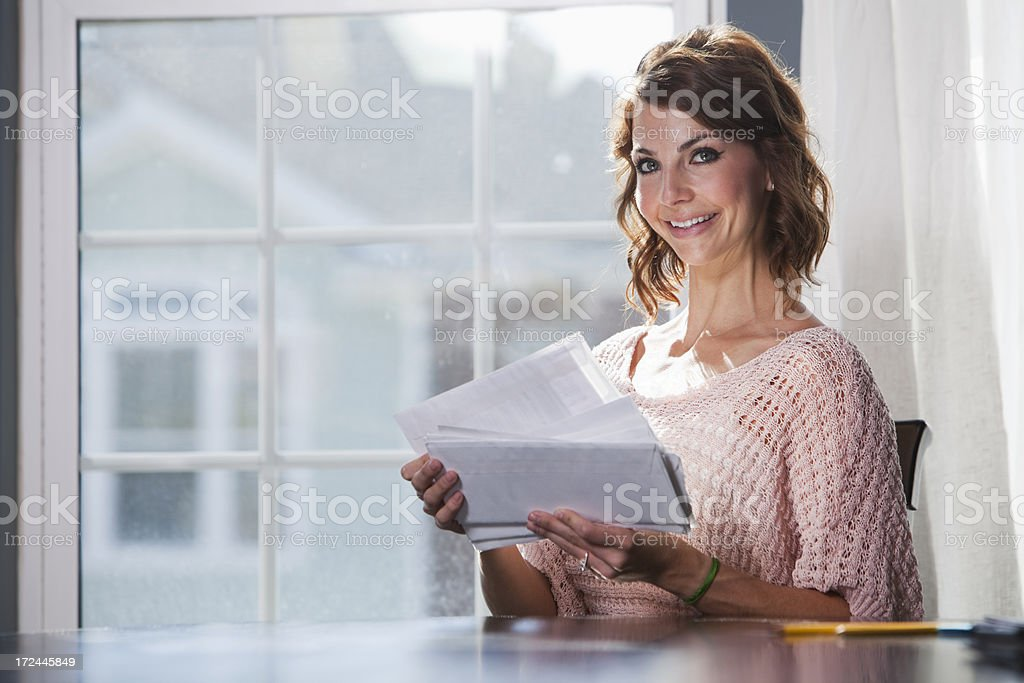Woman looking through mail stock photo
