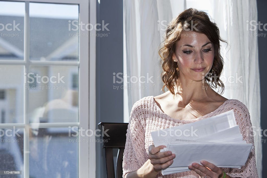Woman looking through mail royalty-free stock photo