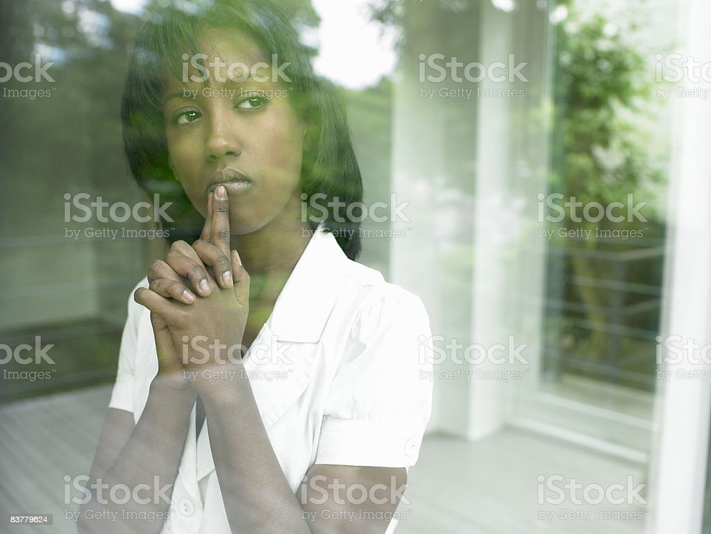 Woman looking through the window royalty-free stock photo