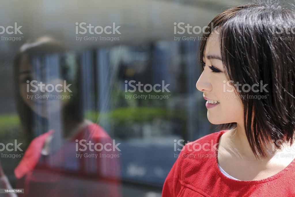 Woman Looking Through Window - XLarge royalty-free stock photo