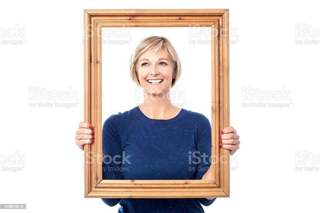 Woman looking through wooden frame - Royalty-free Adult Stock Photo