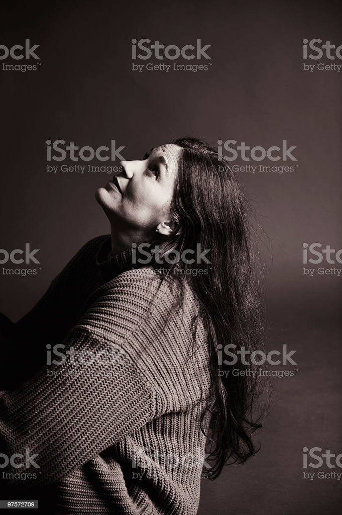 Woman looking up in thought royalty-free stock photo