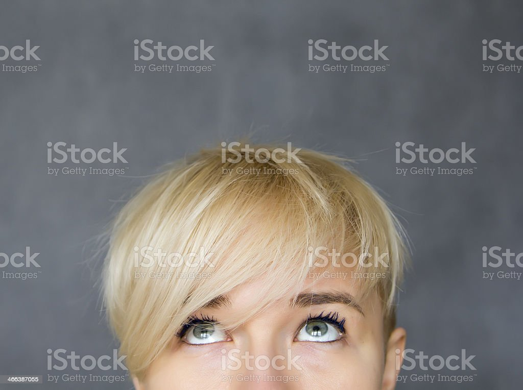 woman looking up stock photo