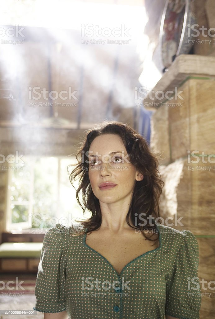 Woman looking up, smiling, close-up royalty-free stock photo