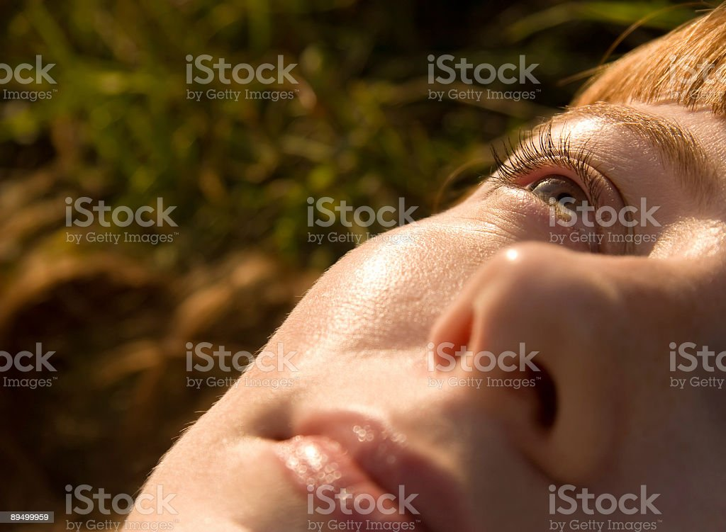 Woman looking up to the sky royalty free stockfoto