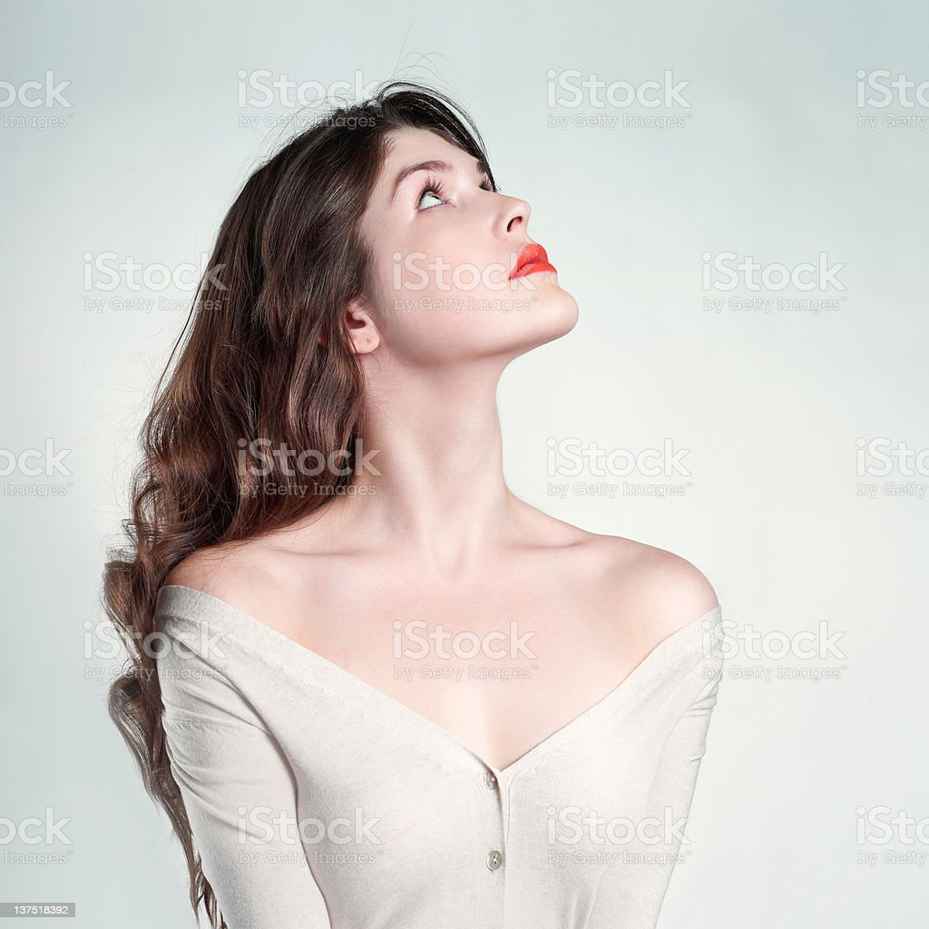 Woman looking up with exposed neckline stock photo