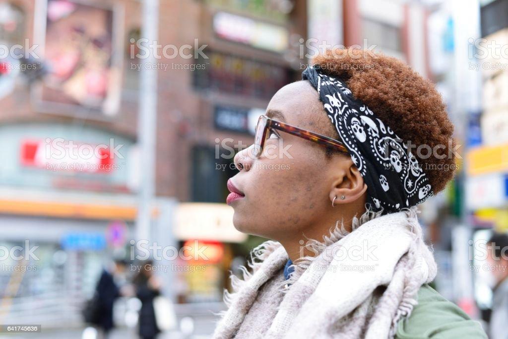 Woman looking upwards stock photo