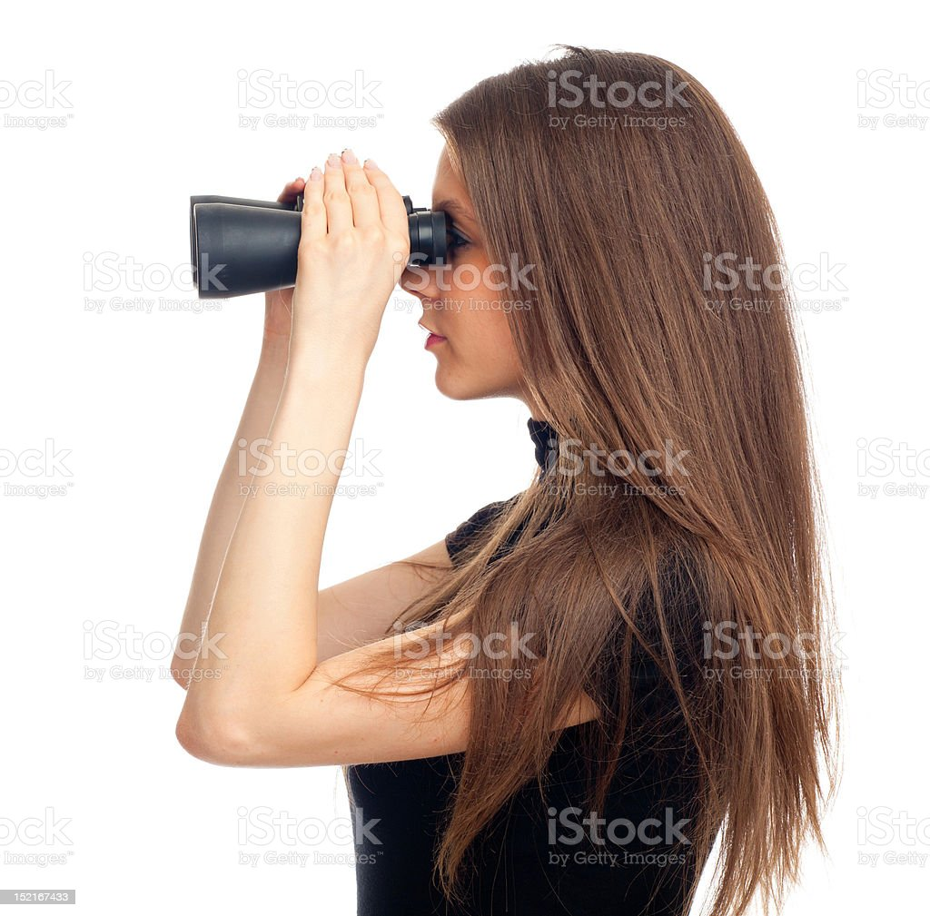 Woman looking with binoculars stock photo