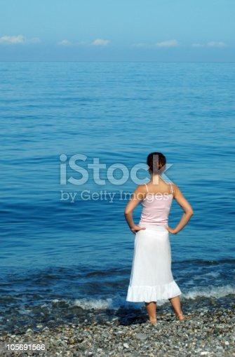 istock Woman looks at blue sea 105691566
