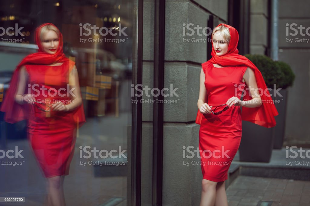 Woman looks at the shop window. stock photo