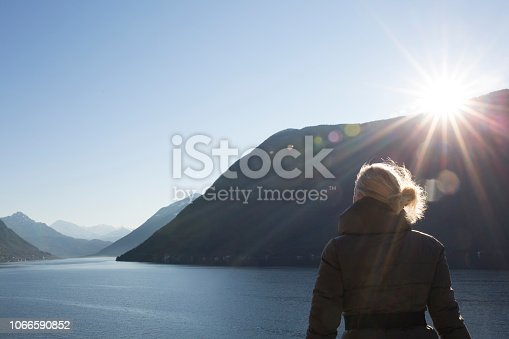 She is above Lake Lugano and looking down valley