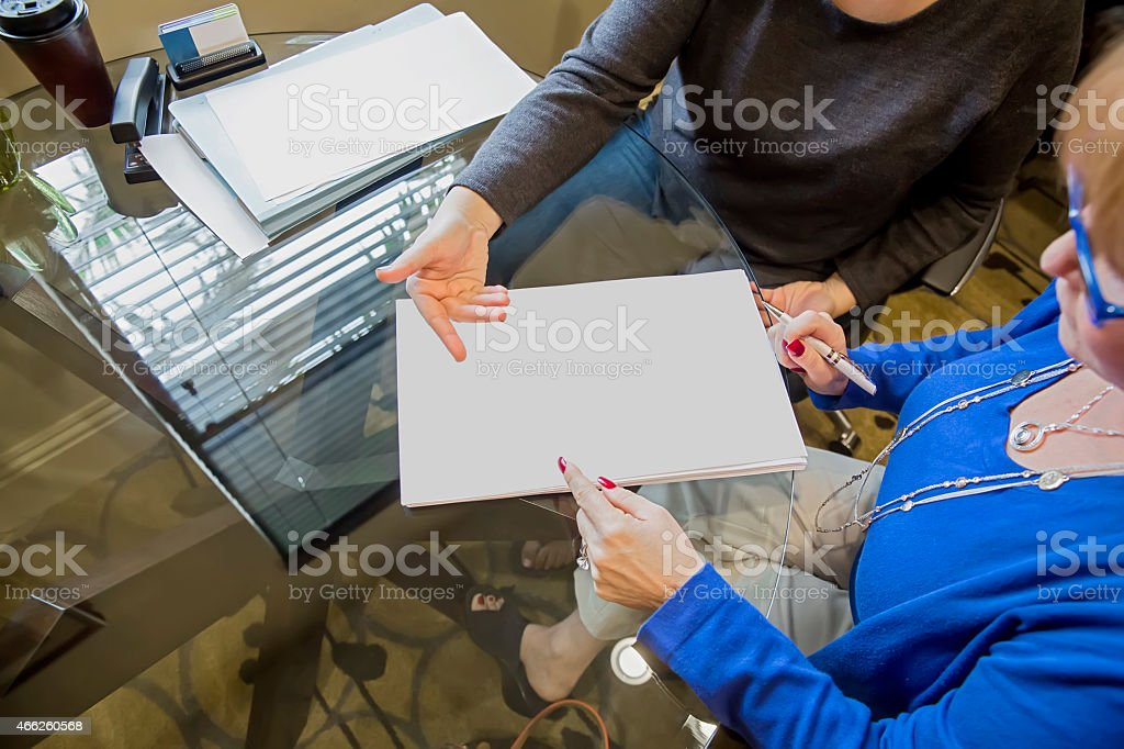 Woman Looks Over Agreement To Buy A New Home Rm Stock Photo More